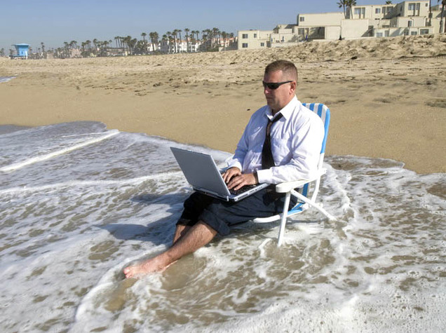 Businessman on beach working